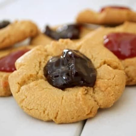 A simple peanut butter cookie indented in the middle and filled with strawberry preserves. It's a peanut butter and jelly sandwich in cookie form.