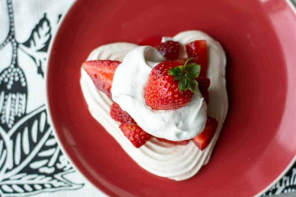 Heart Meringues with Berries and Cream- so light and refreshing, they're a perfect dessert for Valentine's Day.