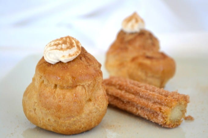 These Churro Cream Puffs are a simple Pâte à Choux filled with a sweetened cinnamon whipped cream and sprinkled with some cinnamon sugar to top it off.