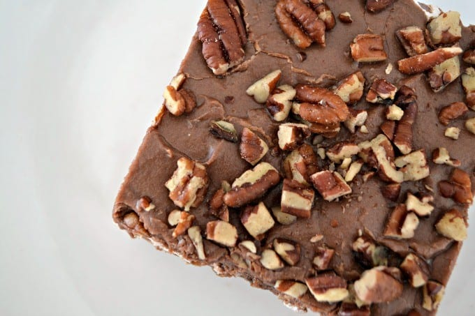 Mississippi Mud Cake is a rich chocolate cake pecans and coconut, topped with a layer of marshmallow cream, chocolate frosting and more pecan pieces.