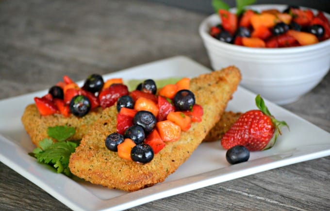 Parmesan crusted Cod accompanied by a fresh strawberry, blueberry and mango salsa - a delicious and easy dinner that's ready in under 30 minutes!