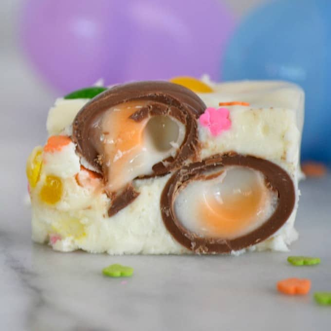 Easter Fudge is white chocolate with mini Cadbury Creme Eggs, and Starburst Jelly Beans - the perfect sweet treat to serve your little bunnies for Easter!