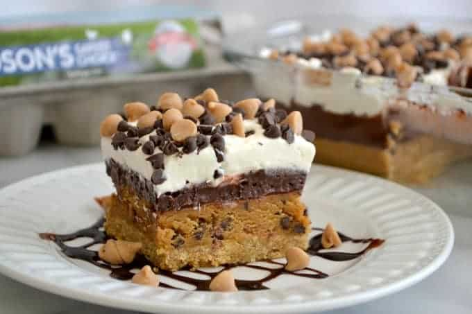 Peanut Butter Cookie Dough Dream Bars topped with mini chocolate and peanut butter chips for a fabulous no bake dessert to wow family and friends!