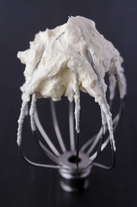 Whipped Cream with Cream Cheese on a whisk.