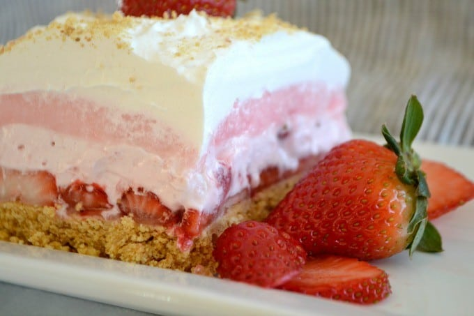 These Strawberry Cheesecake Dream Bars are layers of graham crackers, strawberries, and more. It's the perfect NO-BAKE dessert for strawberry season!
