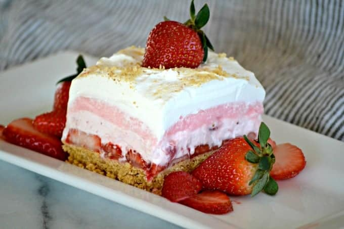 Strawberry Cheesecake Dream Bars on a white plate.