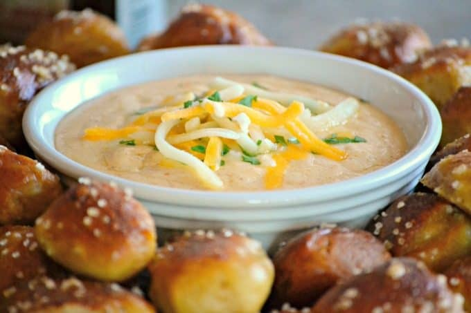 This Beer Cheese Dip and Homemade Pretzel Bites is a smooth, slightly spicy cheese dip with a touch of your favorite brew that goes perfectly with the easy homemade pretzel bites.