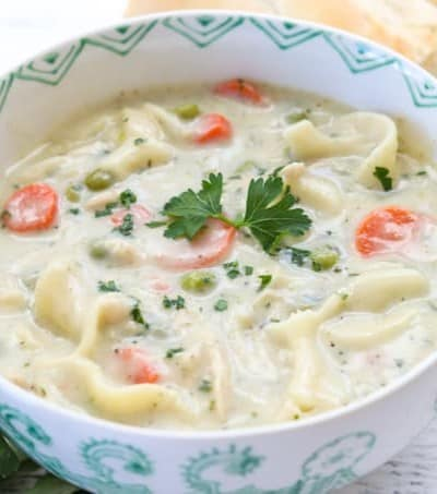 This creamy Homemade Chicken Noodle Soup recipe with chicken, noodles, peas and carrots is a flavorful dish that is super easy to make.