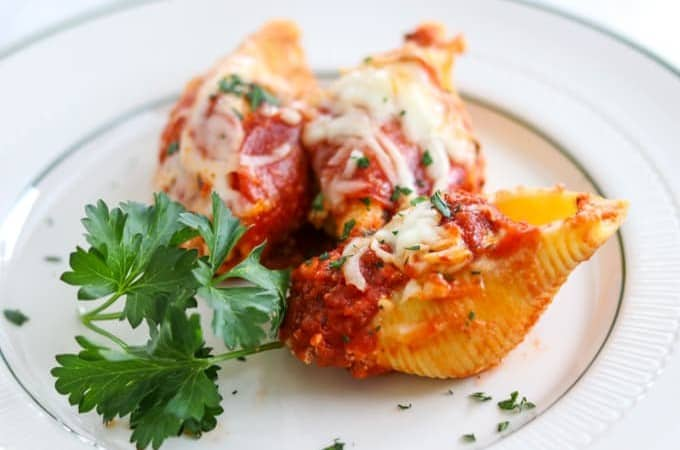 Pepperoni Pizza Stuffed Shells are pasta shells stuffed with ricotta and Parmesan cheese, diced pepperoni, and topped with pizza sauce.