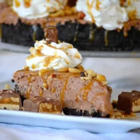 This No Bake Nutella Snickers Pie from Julianne Bayer's cookbook, No Bake Treats: Incredible Unbaked Cheesecakes, Icebox Cakes, Pies and More, is going to be a hit this summer with the delicious creamy Nutella filling, salted caramel and chopped Snickers on top.