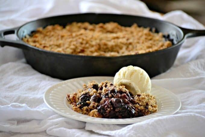 This Skillet Blueberry Crisp with fresh blueberries, an almond oatmeal topping and topped with a scoop of vanilla ice cream, make it the perfect dessert!