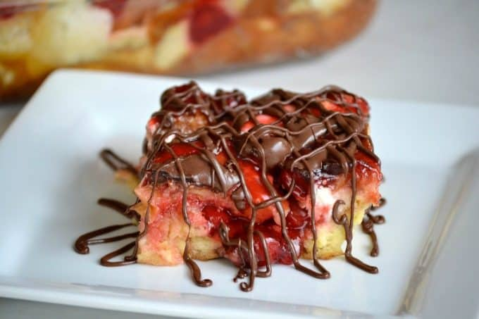 This Chocolate Cherry Cheesecake Bread Pudding with French bread, cream cheese, cherry pie filling and chocolate drizzle make this a memorable dessert!
