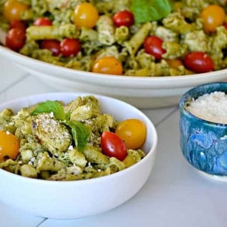 This Pesto Chicken Pasta Saladis pasta, diced chicken, tomatoes and diced mozzarella tossed in an easy pesto. It can also be a side without the chicken!