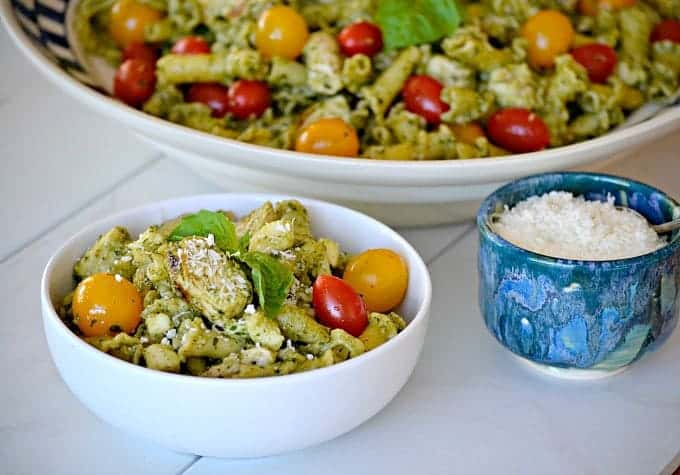 This Pesto Chicken Pasta Salad is pasta, diced chicken, tomatoes and diced mozzarella tossed in an easy pesto. It can also be a side without the chicken!