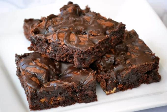 These Chocolate Overload Loaded Brownies are super easy - made with a box mix, chopped candy bars, chocolate sauce and drizzled with chocolate frosting. If you've got a chocolate or sweet tooth craving, these are sure to satisfy it!