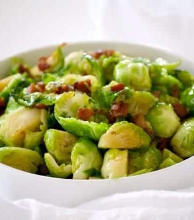These Maple Bacon Brussels Sproutsare Brussels sprouts cooked in a skillet with bacon, some brown sugar and maple syrup. This is a great side dish to serve with any dinner and will convert your Brussels sprouts hater.