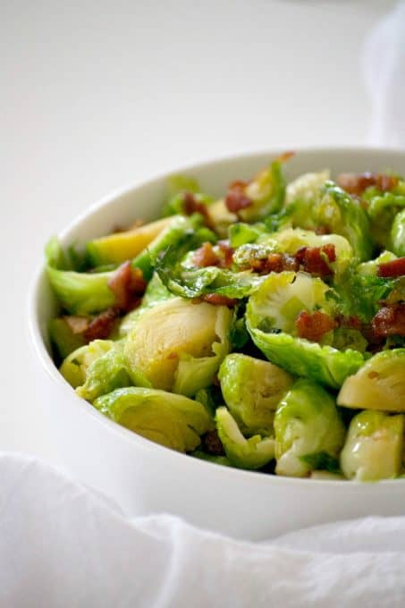 These Maple Bacon Brussels Sprouts are Brussels sprouts cooked in a skillet with bacon, some brown sugar and maple syrup. This is a great side dish to serve with any dinner and will convert your Brussels sprouts hater.
