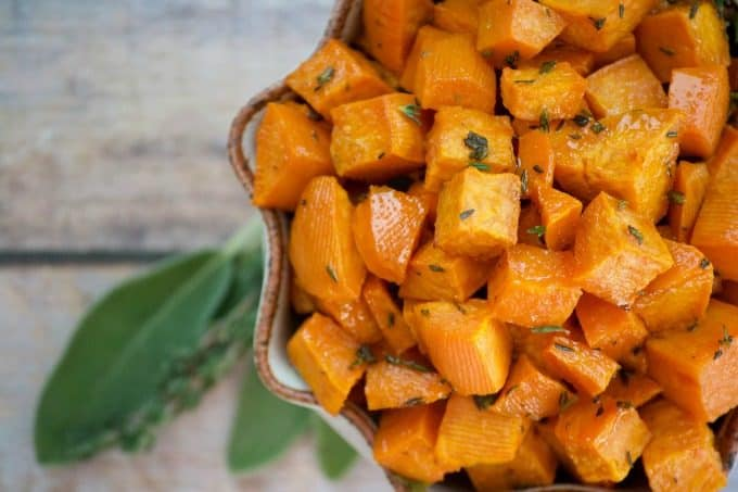 These Maple Roasted Sweet Potatoes are diced sweet potatoes tossed with olive oil, fresh sage and thyme, drizzled with pure maple syrup and roasted to perfection. They're the perfect side dish for your holiday table!