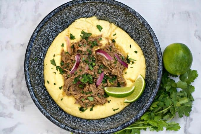 Slow Cooker Beef Chili Verde with Polenta are savory beef short ribs with salsa verde. Serve with polenta and you've got a super easy and delicious dinner.