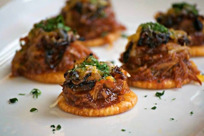 These Sweet and Spicy Coca-Cola Shredded Pork Bites are RITZ crackers topped with a bit of pork, caramelized onions, melted cheese and a dash of cilantro. Your Game Day taste buds will never be the same!