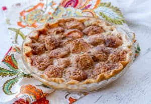 An apple pie with cinnamon sugar and heavy cream.
