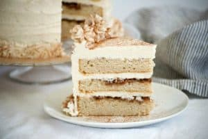 This Cinnamon Roll Layer Cake is a three layer cake with each layer covered in a cinnamon glaze and completely frosted with a incredible cinnamon frosting. A great recipe in Lindsay Conchar's (founder of the blog Life, Love and Sugar) new cookbook, Simply Beautiful Homemade Cakes: Extraordinary Recipes and Easy Decorating Techniques.