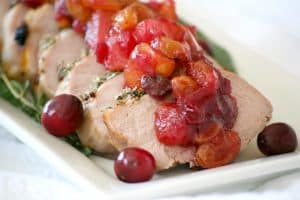 This Dijon Herb Roasted Pork with Cranberry Pear Chutney made with a Smithfield Prime Pork Tenderloin is an easy and delicious dinner perfectly suited for holiday entertaining!