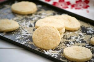 These Coconut Macadamia Sugar Cookies is a butter shortbread cookie with shredded coconut and macadamia nuts to remind you of the tropics.