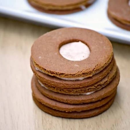 These Cream-Filled Molasses Cookies are a tasty gingerbread sandwich cookie with a cinnamon cream filling in the middle. They're great with a glass of milk!