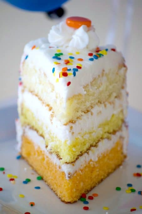 This ombre Citrus Layer Cake with vanilla, lemon and orange layers is colorfully decorated and adorned with helium-filled balloons - a fun birthday cake!