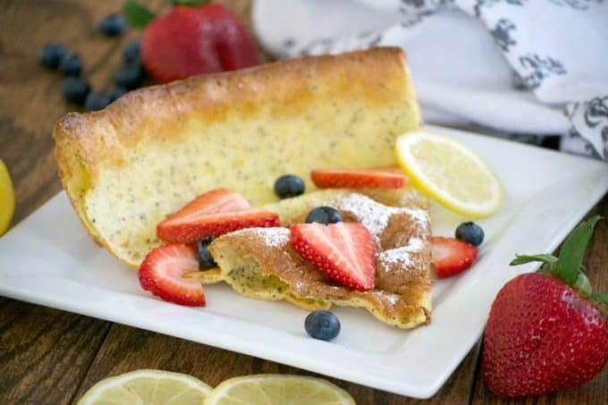 This Lemon Poppy Seed Dutch Baby is a light and fluffy pancake baked in the oven. With a light lemon flavor, it's a perfect breakfast treat for the weekend.