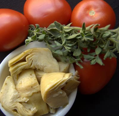 Fresh herbs, tomatoes, chicken, artichokes and cheese, make this Artichoke Tomato Chicken a super easy meal that is on the table in less than 30 minutes!