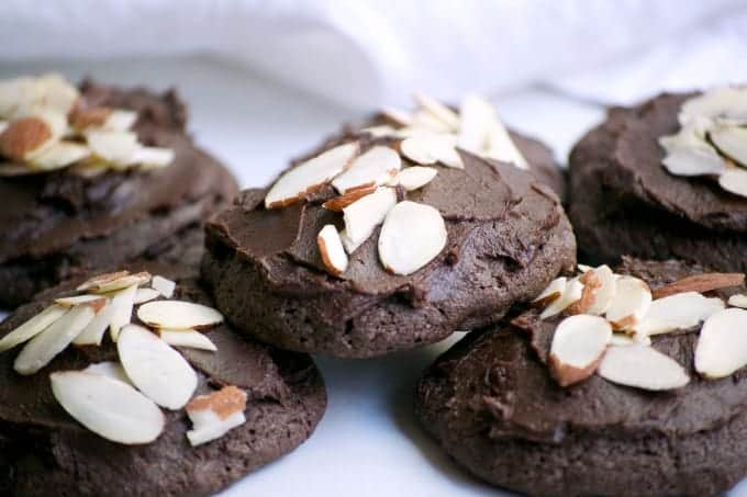 These Double Chocolate Frosted Almond Cookies, made with Fair Trade products are sure to satisfy any chocolate craving. Almond paste, sliced almonds, double chocolate chips and chocolate frosting make these cookies very hard to resist! Make them and help support Fair Trade communities.