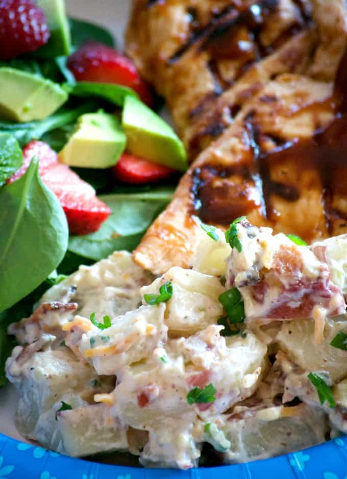 Our Loaded Red Bliss Potato Salad with all the fixin's - a dijon-mayo dressing, bacon, green onions and cheese is a potato salad you'll eat all summer long!