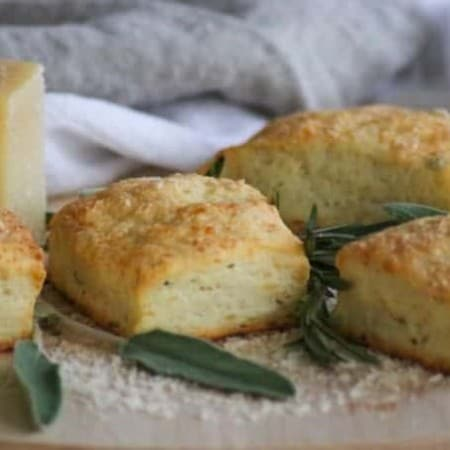 These Asiago Herb Biscuits with shredded Asiago cheese, and fresh herbs are a tasty and easy to make side dish, and they're on your table within 30 minutes!
