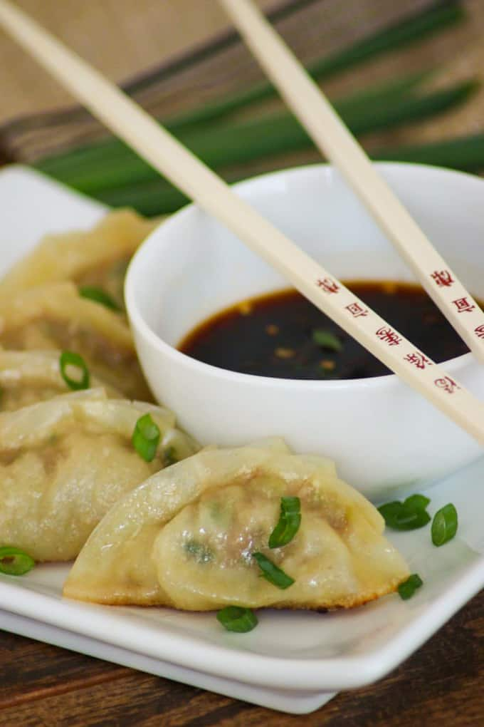 These easy Pork Potstickers with ground pork, ginger, garlic, cabbage and soy sauce wrapped in a light dough are perfect as an appetizer or main course!