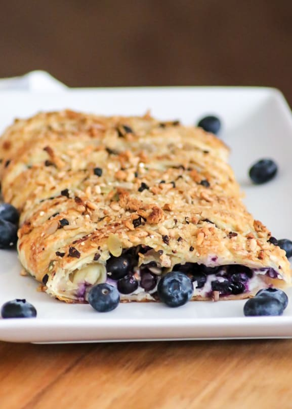 This Blueberry Ginger Cheese Danish is quickly going to become your new favorite breakfast treat! A slice of Puff Pastry with sweetened cream and blueberry ginger filling sprinkled with McCormick® Good Morning Blueberry Ginger Breakfast Toppers is hard to resist.