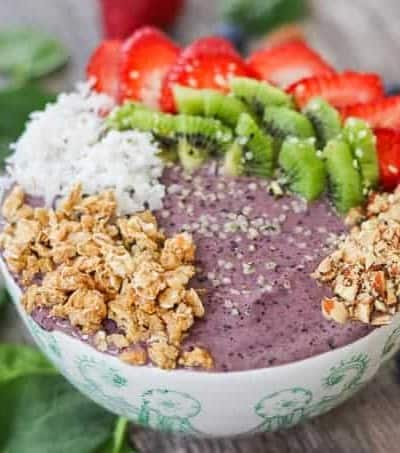 Blueberry Banana Smoothie Bowl with strawberries, kiwi, coconut, granola, and hemp seeds