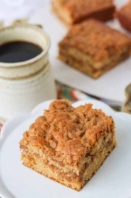 A slice of Coffee Cake made with cinnamon and sour cream.