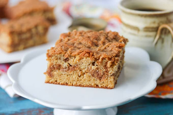 A slice of coffee cake on a small cake plate.