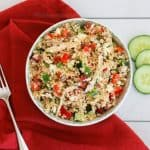 A bowl of Greek Quinoa Chicken Salad made of cooked chicken, bell peppers, feta cheese and quinoa. Easy and delicious doesn't get better than this!