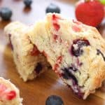 Delicious Mixed Berry Scones on a wooden tray made with Fair Trade Certified strawberries and blueberries.
