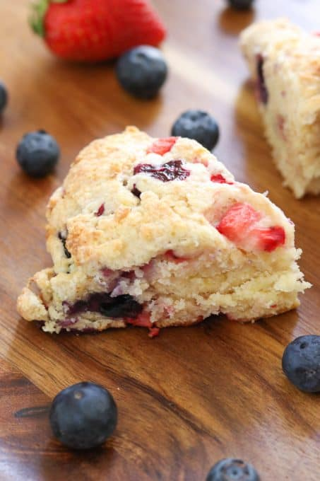 Mixed Berry Scones on wooden tray.