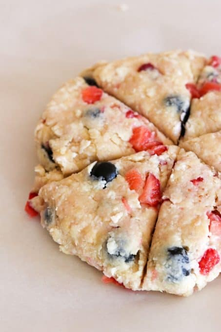 Mixed Berry Scones before baking on a parchment lined baking sheet.