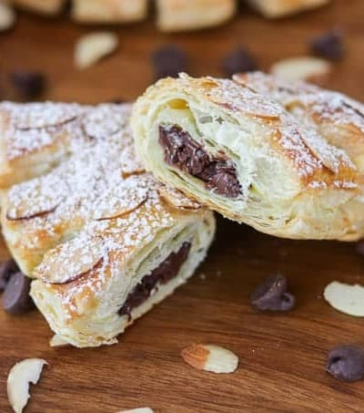 Look at all the delicious chocolate inside these Chocolate Bear Claws! They're made with puff pastry, chocolate chips, almonds and sprinkled with powdered sugar.