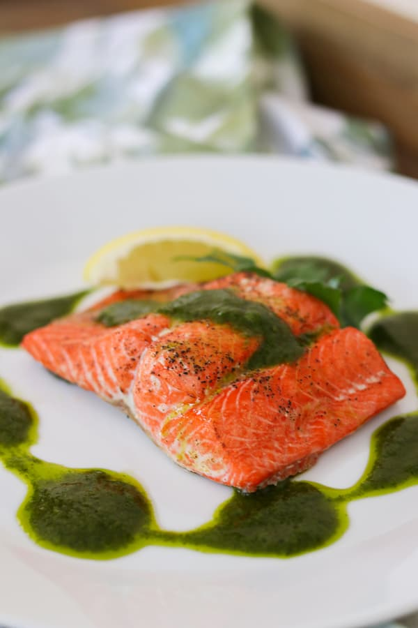 Roast salmon seasoned with olive oil, salt and pepper and topped with a delicious Chimichurri sauce.