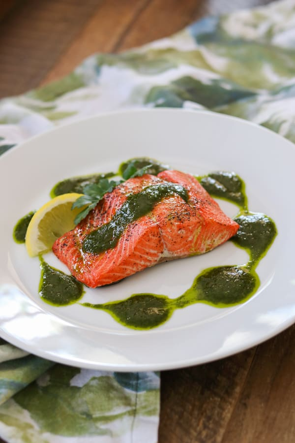 Increase the flavor, by adding a chimichurri sauce made of parsley, cilantro, olive oil and cumin to your roast salmon!