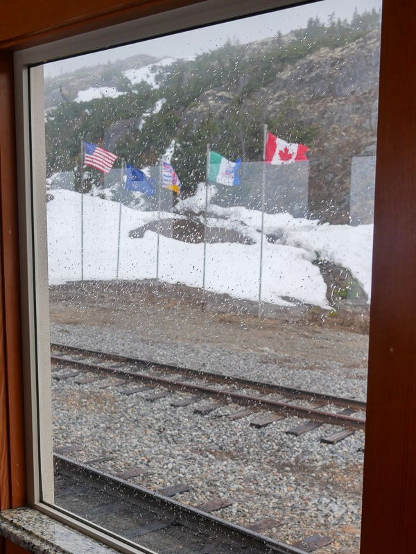 Flags at the US / Canada border on the White Pass Scenic Railway tour.