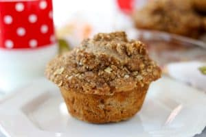 One Apple Streusel Muffin on a plate.