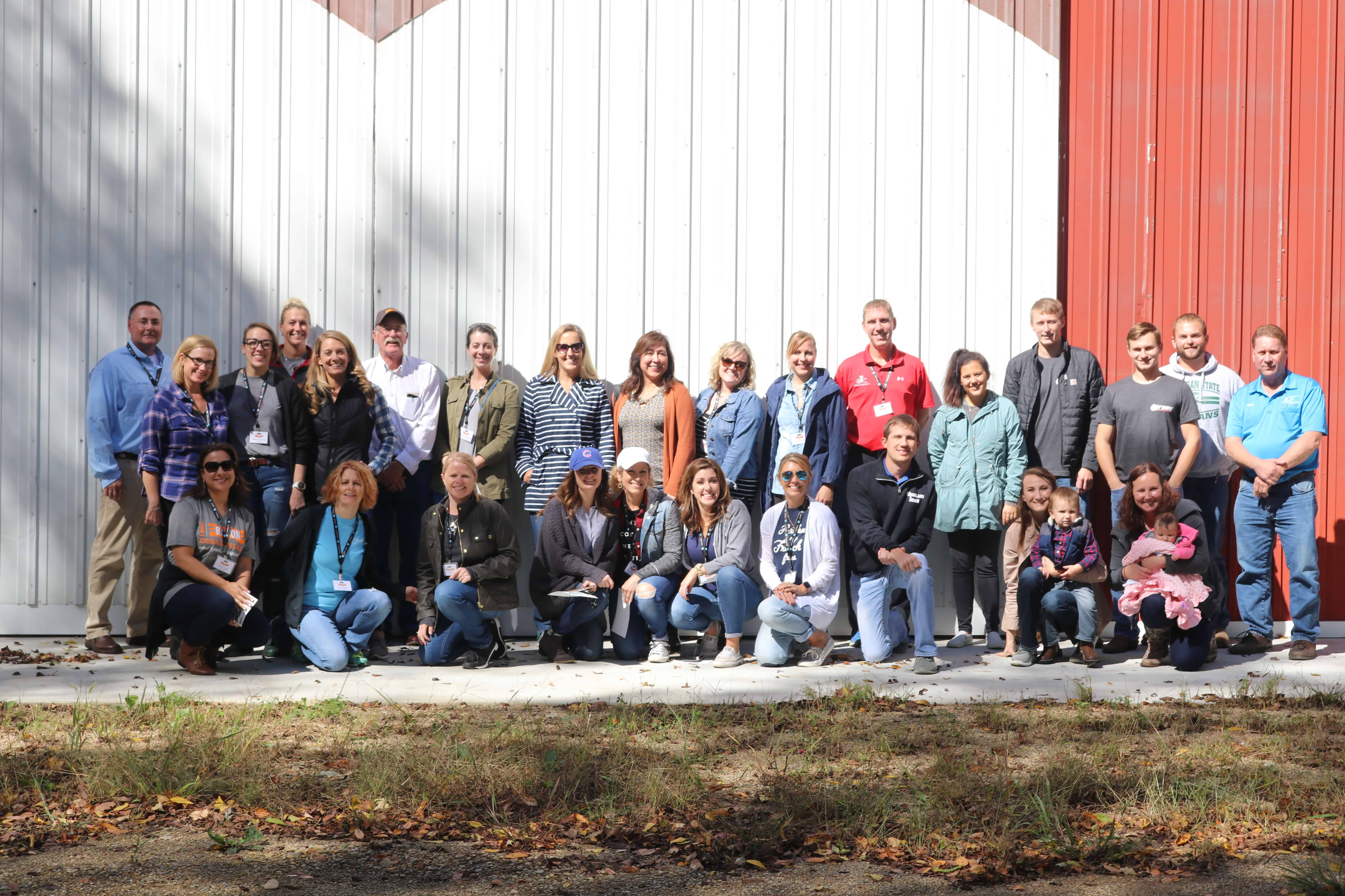 Food Bloggers and farmers touring pig farms in MI.